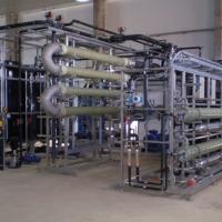 WEHRLE Hybridverfahren bestehend aus einem Hochleistungs-MBR (Bild: externe, tubulare Ultrafiltration, UF) und einer Nanofiltration (NF) auf Skids vormontiert zur Behandlung von Deponiesickerwasser